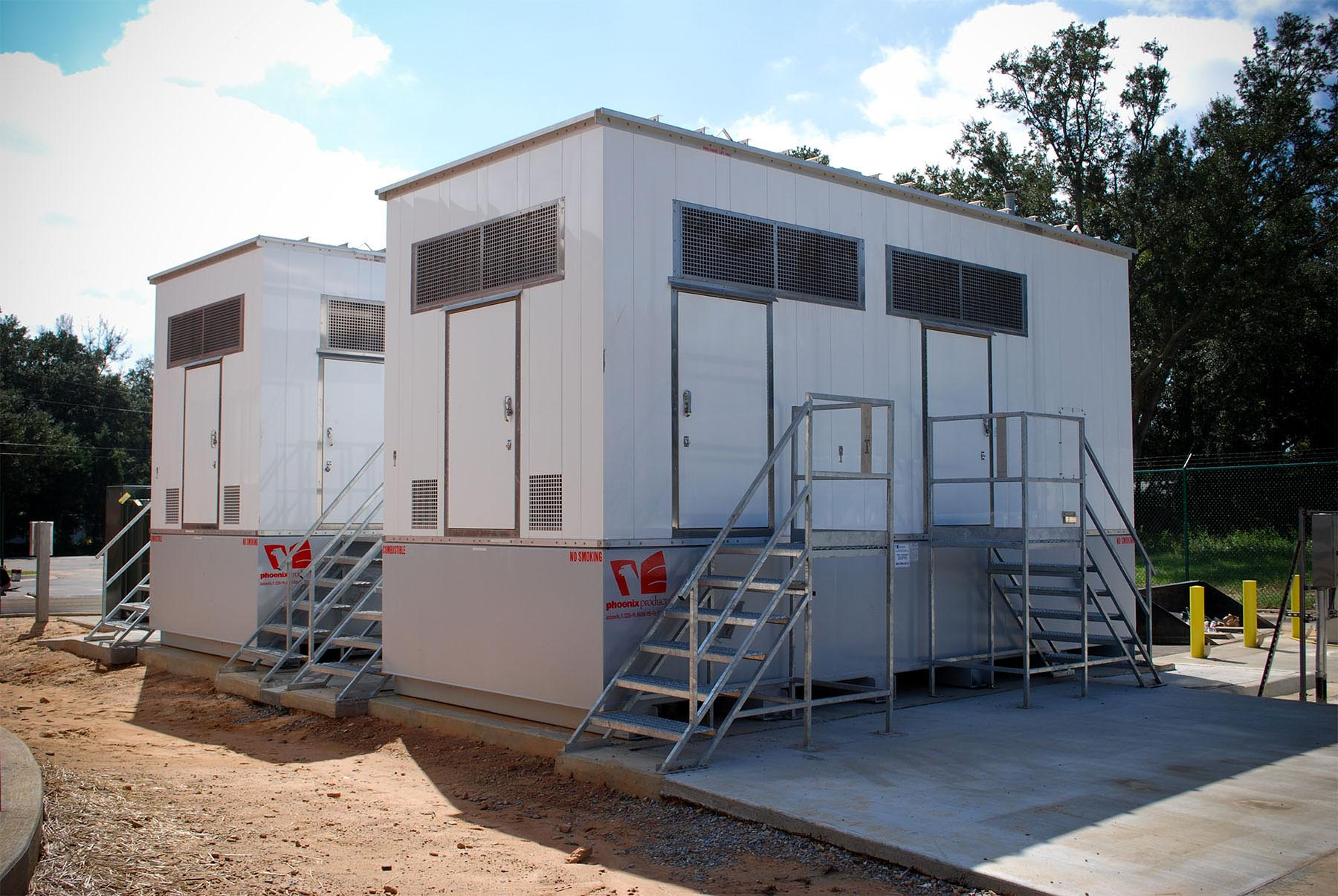 Custom-Generator-Enclosures-With-Sub-Base-Fuel-Tanks-And-Custom-Stairs-For-Lift-Station